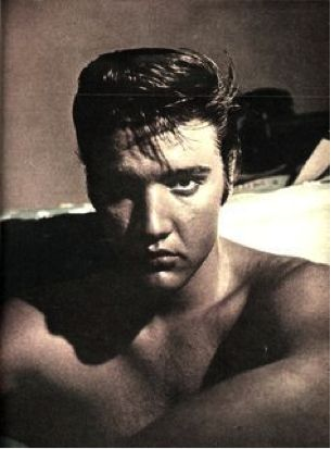"""Elvis Presley photographed in a room on the sixth floor of the Peabody Hotel in Memphis, TN, last week of July 1956. Photo by journalist Lloyd Shearer, on assignment for """"Parade"""" magazine. Later that day Elvis would get a fresh haircut at Jim's Barber Shop on Main Street in Memphis. Also see a colorized version: https://de.pinterest.com/pin/380906080965474693/"""