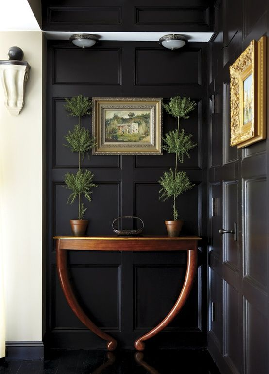 love. Black paneled entry with hidden door on the right side http://emfurn.com/collections/dining-chairs