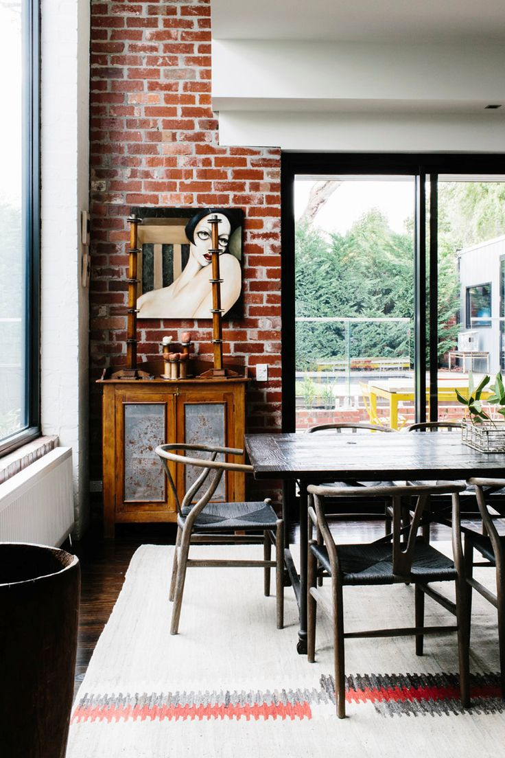 Wonderful Design For Industrial And Ethnic Warehouse With Black Wooden Dining Table Chairs Brick Wall