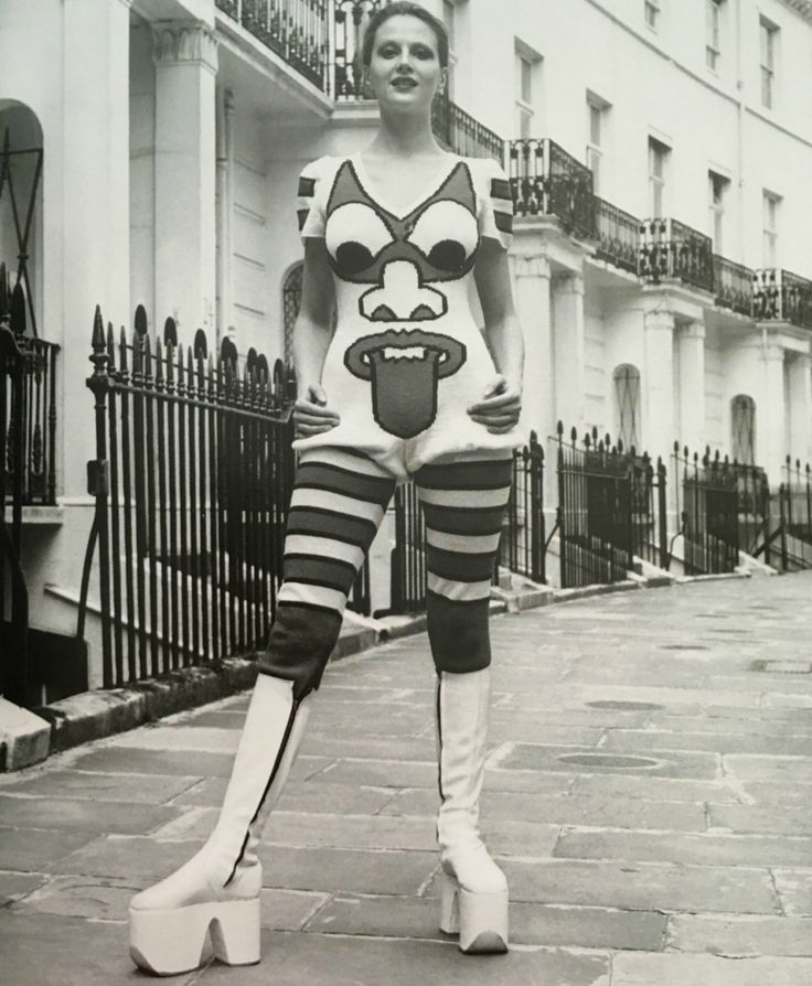 """Artist, journalist and political activist Caroline Coon models white platform zip-up boots and a hand-knitted graphic jumpsuit with tight hooped leggings with bloomer effect by Kansai Yamamoto in 1971. Yamamoto went on to design the Ziggy Stardust outfits for David Bowie."" - sourced from Vintage Fashion by Ottlie Godfrey"