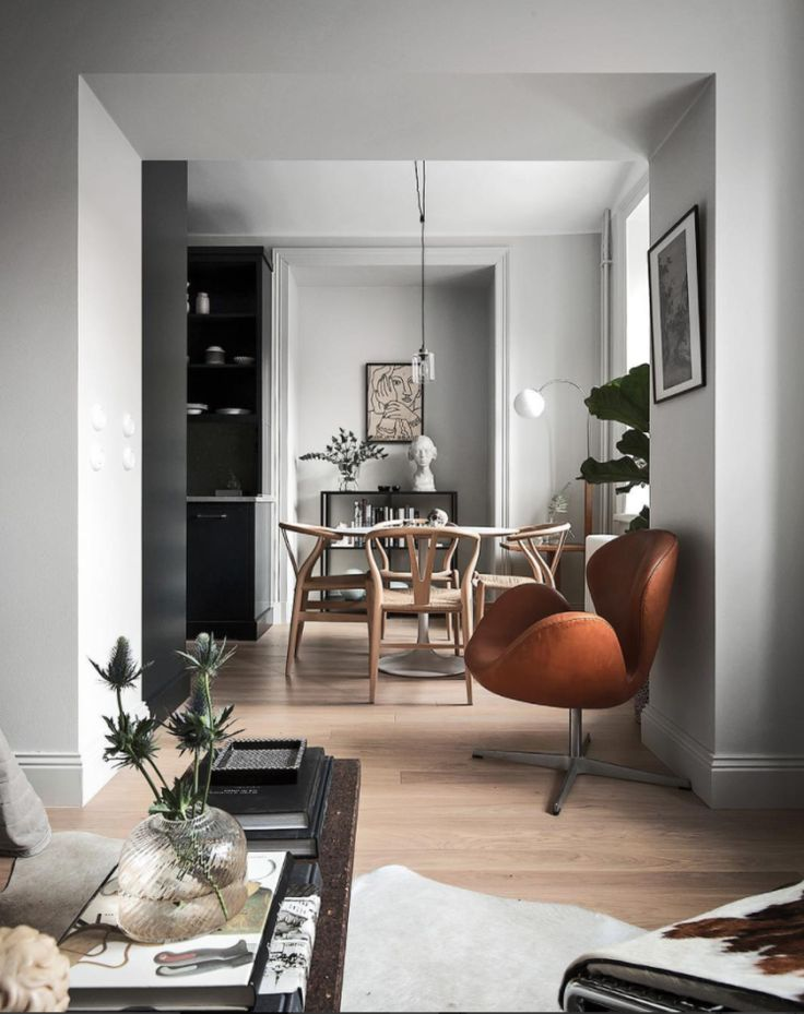 Soft grey walls (Pavilion by Farrow & Ball) | leather Swan chair | Wishbone dining chairs | black accents | 10 Beautiful Rooms - Mad About The House