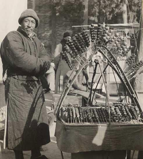 Picture Show: Memory of Old Beijing  - Photographer: Hedda Morrison (1908-1991). A Tanghulu* Vendor (this picture was taken in the late 1930's)