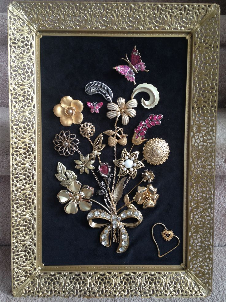 Jewelry flowers on velvet framed by an old mirror frame. The crafty artisan Judith Cary.