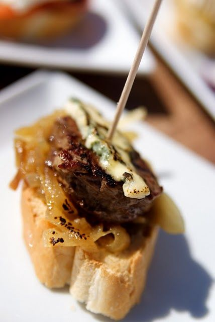 steak bruschetta tapas: no link but great idea. Grilled onion, steak and blue cheese on bread. Spreads a long way.