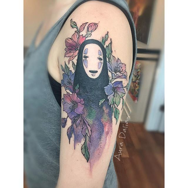 """This no face tattoo was designed by Audra Auclair. This tattoo was inspired by her print """"Renewed."""""""