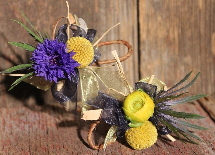 blue and yellow rustic wrist corsage with craspedia, ranunculus, bachelor buttons, and thistle -accented with raffia, on bark wire