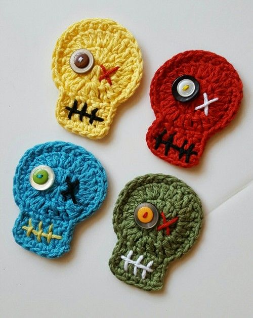 Braains! These zombie magnets will be a hit at your next Walking Dead get-together. These heads are crocheted from cotton yarns in gangrene green, bloody red, sickly yellow and bruise blue. Each has