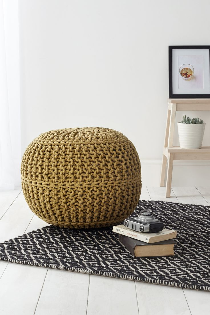 Hygge decor ideas: Perfect for additional seating or a foot rest, this knitted pouffe in a beautiful cotton crochet from BHS will deliver on practicality, comfort and style. Find more ideas at housebeautiful.co.uk