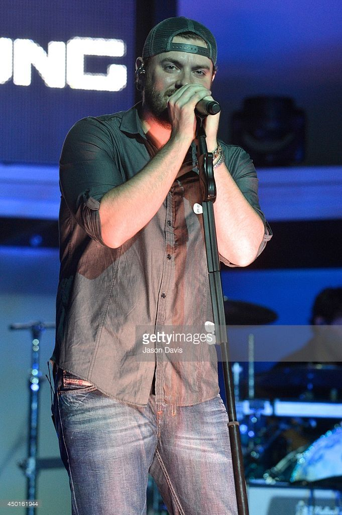 Recording Artist Chris Young performs during the Chris Young Fan Club Party on The General Jackson Showboat on June 5, 2014 in Nashville, Tennessee.