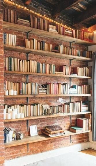 Floor To Ceiling Bookshelf On An Exposed Brick Wall