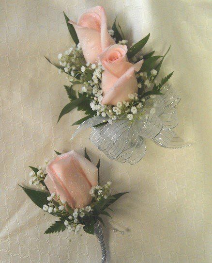 Pink rose corsage and boutonniere set from Floral Fashions