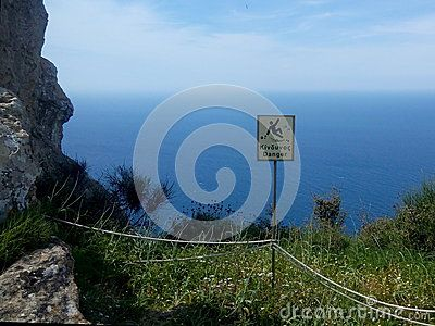 Danger sign on the edge of a cliff in Greece as a warning to visitors. Taken in north-east Corfu as the economic future of Greece hangs in the balance.