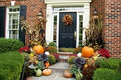 When the leaves begin changing and the pumpkins start arriving in the stores it can only mean one thing: it's time to start decorating your home for fall. You can easily create a welcoming front entrance by dressing it up with rustic fall finds and hanging a wreath on the door or on the wall to bring some of that fall color to eye level.