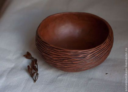 Red earthenware hand carved milk fired bowl.
