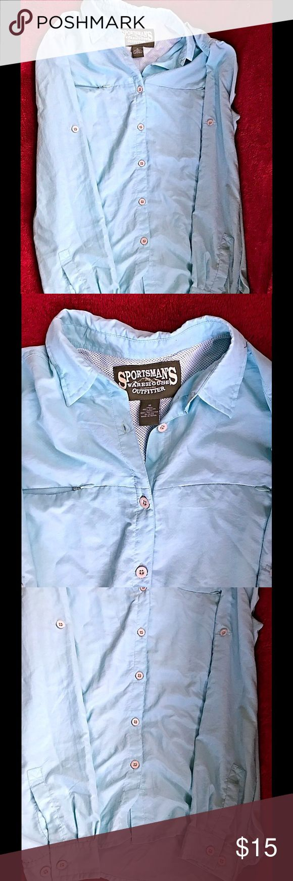 Womens Lost River Fishing Shirt This is new, never worn with tags. It is a powder blue women's outdoor button down shirt. Size medium. 100% nylon. Shirt marked Sportsman Warehouse Outfitter on the inside tag. And Sportsman Warehouse machine stitched int to the upper back of the shirt. The original tags state Lost River  Women's  fishing Shirt, Sun protective fabric. This shirt was in a smoke and pet free home. Sportsman's Warehouse Tops Button Down Shirts