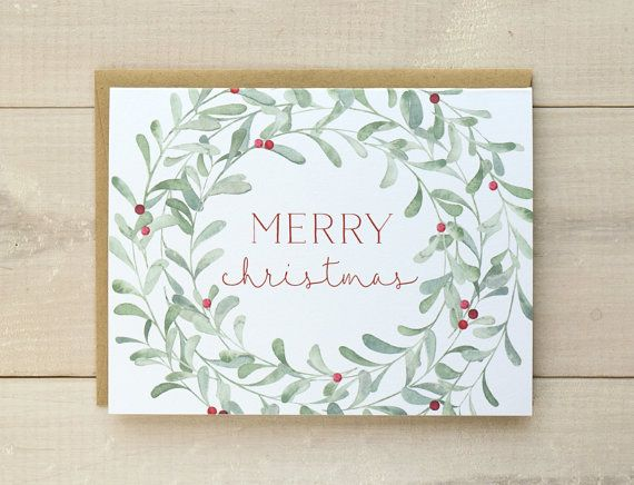 Wreath Christmas cards featuring an original illustration with hand painted watercolors. Pale green watercolor wreath with red berries and a Merry