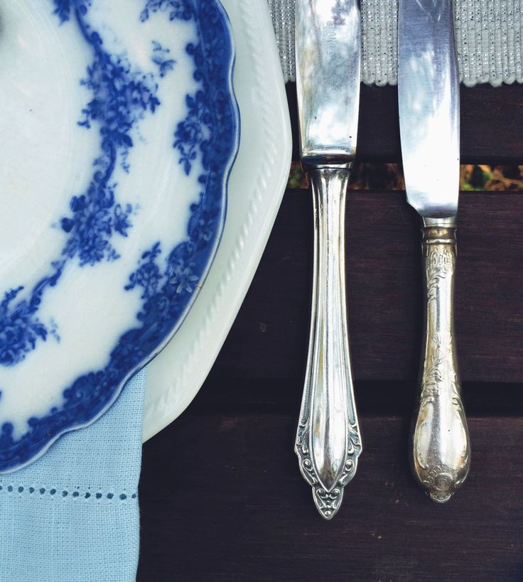 Vintage cutlery. Blue and white plates, silver cutlery,