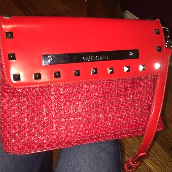 Valentino By Mario Valentino Crossbody Bag Purchased and only used once, practically NEW! It's a vibrant color red that will make any outfit POP! I love the straw netted detail in the front of this bag! It's been stored in my closet forever it needs new Life!!! Valentino Bags Crossbody Bags