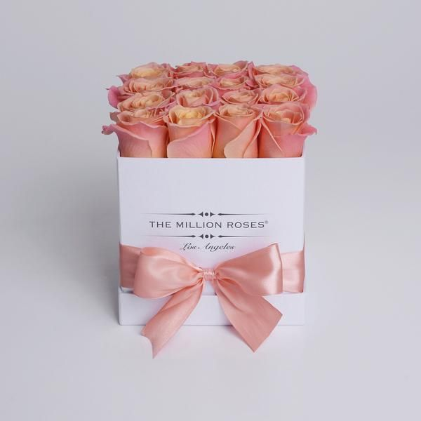 Hand crafted luxuryquality box.Approximately 16stems of peach/sunmaster roses.