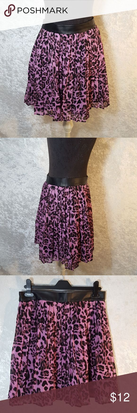 Purple safari cat skirt Size large by Forever 21.  100% polyester pleated skirt. Purple and black cheetah leopard safari cat print.  Waistband is pleather like over the skirt with black liner that is more silk like.  Great for date night, girls night out, or even a goth look.  Used condition not brand new. Has small puncture hole on back of waistline from price tag. Feel free to ask questions or request more photos. I do bundle discounts and accept offers.  Thanks for looking and happy…