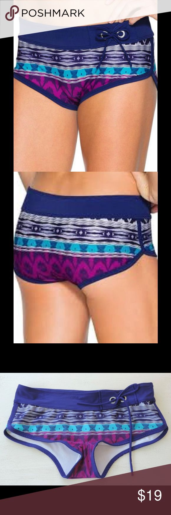 """ATHLETA Small BELIZE Dolphin Shorts BIkini Bottoms **NO Trades Please** EXCELLENT used condition.. may have been worn once!!  """"Belize Dolphin"""" BikiniSwim Bottoms/Shorts~Purple, Magenta, Aqua, Blue & White Geometric Print... Solid Purple-Blue Trims & Waistband~ Rated UPF 50+ ~Sits Straight Across Waist & Low on Hips - Full Seat Coverage ~ Double-Loop Tie on Side of the Waist ~Breathable Fabric  Fabric: Shell: 80% Nylon 20% Spandex ~ Lining: 100% Polyester  Measurements: Waist (front…"""