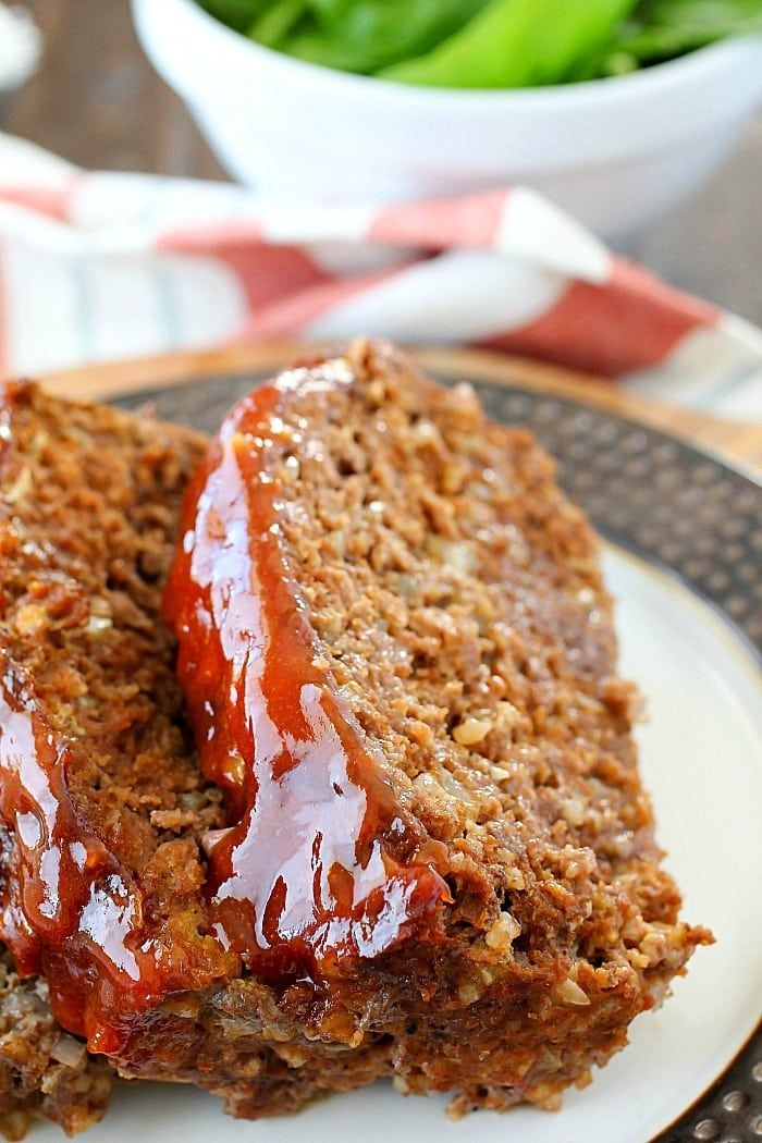 This Meatloaf Recipe is my family's FAVORITE Sunday night dinner! It really is the Best Ever Meatloaf, and it is incredibly easy to make. So much flavor packed inside with a delicious glaze spread on the top!
