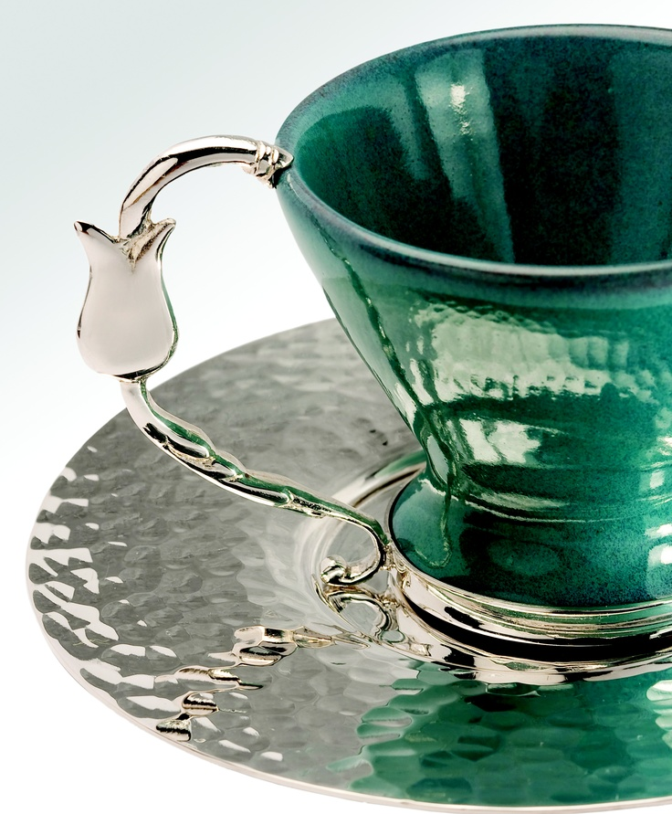Pretty silver tulip on the handle of this teacup.
