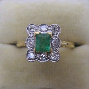 Emerald and Diamond cluster engagement ring