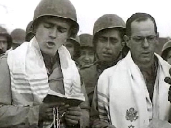 On October 29, 1944 American Jewish soldiers were part of the victorious Allied armies that swept into Germany. A group of them, led by a cantor from Manhattan, conducted a special religious service at the city of Aachen.  For the first time since the advent of Hitler, the exterminator of millions of Jews, a public Jewish service was being held and broadcast live to the United States by NBC.
