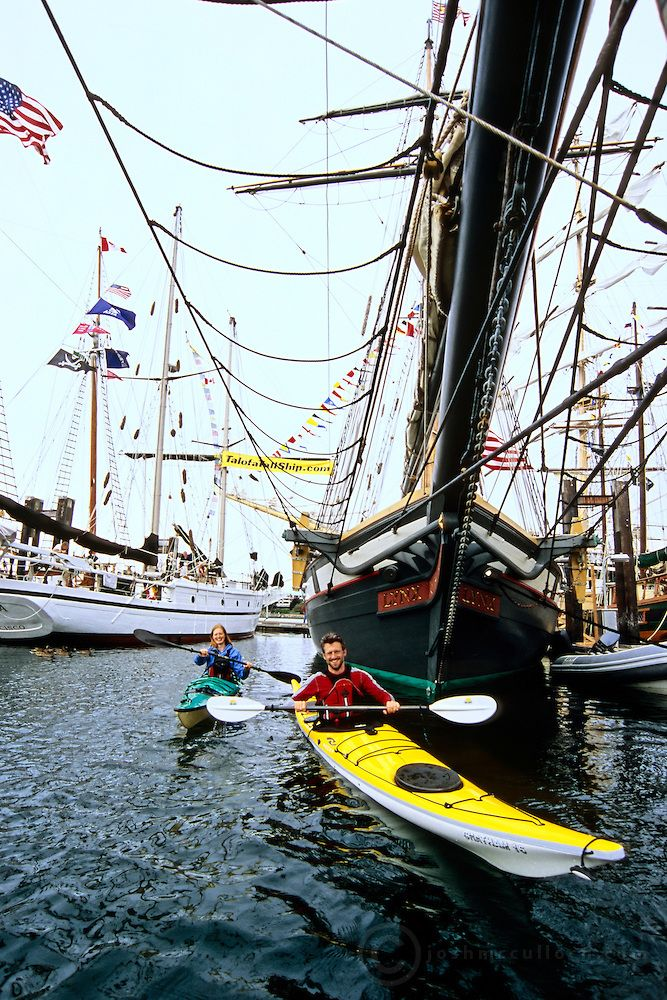 A small size difference...  Sea kayakers at Tall Ships Festival, Vancouver Island, BC | Josh McCulloch