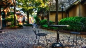 Preview wallpaper garden, plants, sculptures, houses, table, chairs, autumn, leaves 1920x1080