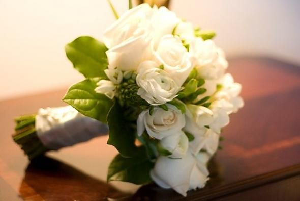 Ivory roses, white ranunculus, white freesia, Star of Bethlehem, green hypericum berries, salal leaves