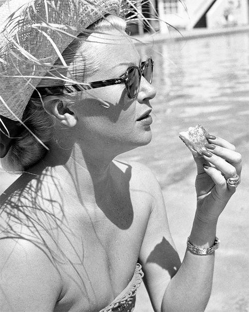 Lana Turner lunching poolside at the Coral Casino in Santa Barbara California, 1951