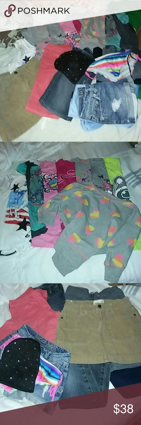Girls bundle size 10 2 pair jeans levis and Arizona one old navy skort 2 pair long shorts old nav6 and george and 8 shirts justice and children's place last photo is last min throw ins a pair of nice justice shorts button needs fixed justice swim suit bottom and a cute hat Justice Other