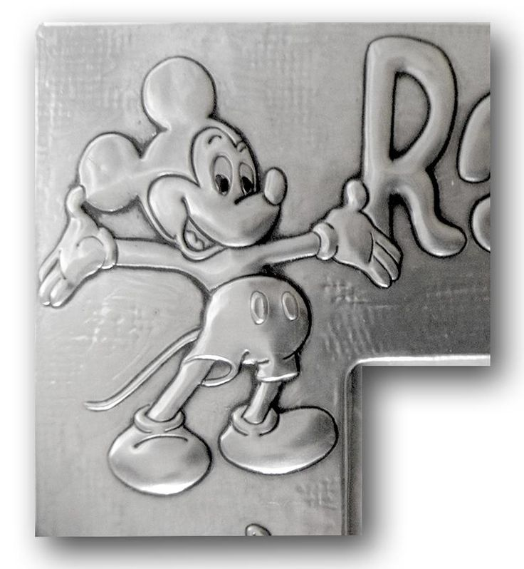 MICKEY MOUSE.    It is not a drawing, it is not a drawing or a painting... it is simply a metalwork. :-)