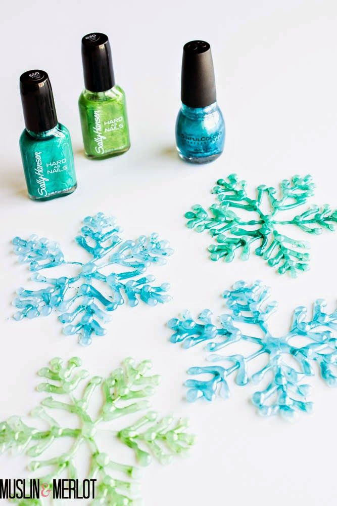 Glue Gun Snowflakes! Easy way to pretty up a holiday table. Wouldn't these be great for a Frozen party?
