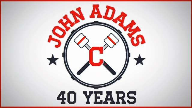 Tribute to drummer :J ohn Adams (born 1951) is a dedicated fan of the Cleveland Indians in Cleveland Ohio. Adams has played his bass drum in the bleacher seats during nearly every Indians home game since 1973, which has brought him notoriety and recognition from the Indians and other organizations. The Indians now pay for two season tickets for Adams and his drum, he has been involved in two ceremonial first pitches, and he is the only fan for whom the Indians have dedicated a Bobblehead…