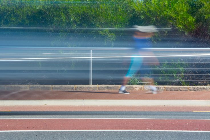 L1M2AS3 Motion Blur ISO100 105mm f/29 1/2sec ND4 filter Nikon D7100 Camera braced on table. I was aiming for just the woman but the car passing at that moment gave streaks that make me think of speed lines.