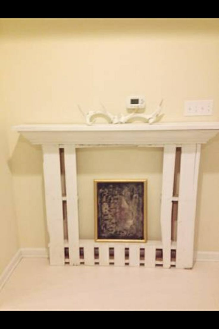 Faux fireplace mantel made from pallets faux fireplace for Cheap wooden fireplace surrounds