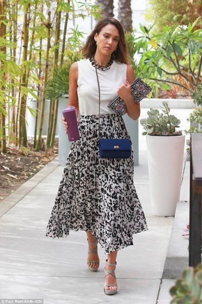 Jessica Alba wearing Chanel Reissue 2.55 Bag, Chanel Clutch and Camilla and Marc Superior Pleat Skirt