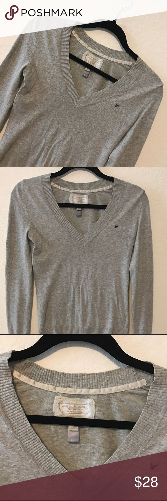 AMERICAN EAGLE SWEATER American Eagle gray sweater.                                 💗Condition: EUC, No flaws 💗Smoke free home 💗No trades, No returns 💗No modeling  💗Shipping next day 💗OPEN TO reasonable OFFERS  💗BUNDLE and save more 💗All transactions video recorded to ensure quality. American Eagle Outfitters Sweaters V-Necks