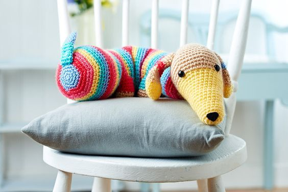 Crochet dog draft excluder - free crochet pattern by Lynne Rowe at TopCrochetPatterns. Registration required.