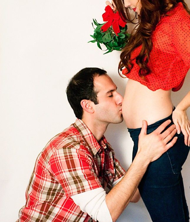 Bring a little mistletoe into your photo shoot for an extra-cute holiday pregnancy announcement.