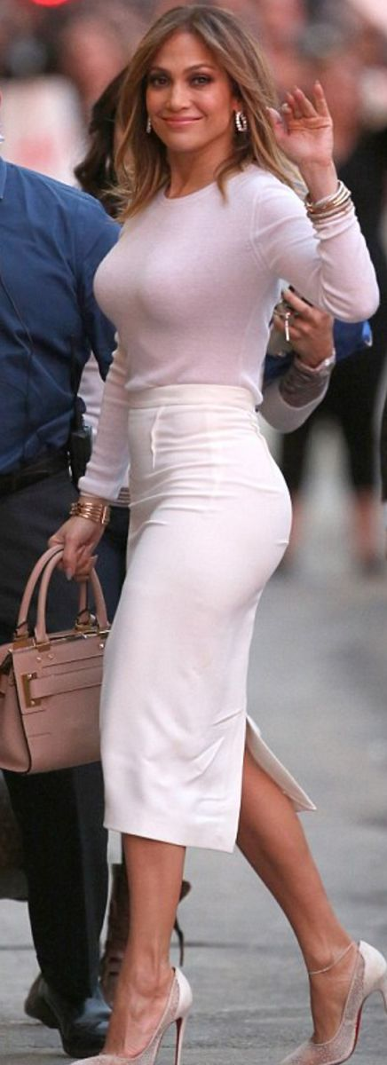 Jennifer Lopez: Purse – Valentino  Shoes – Christian Louboutin  Skirt -Roland Mouret