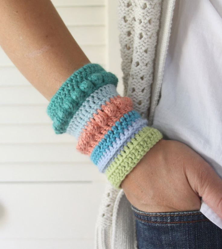 I think I can make this.  crochet cuff bracelet    http://www.etsy.com/listing/80156989/carnival-stripes-crochet-textured-cuff