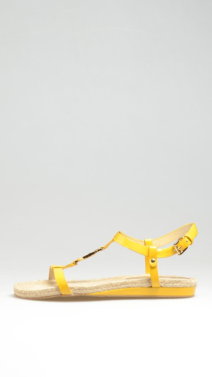 Yellow patent leather sandal, buckle fastening ankle strap, metal logo on front, rope inner sole, rubber sole, 0.99 inch - 2.5 cm heel.