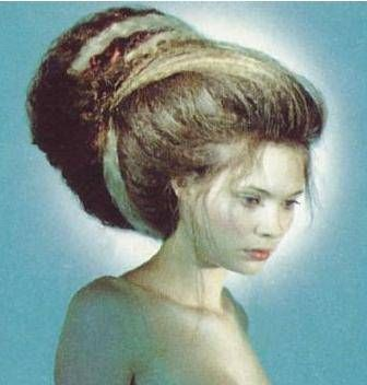 An enormously crimped beehive hairstyle...do NOT attempt this style alone!