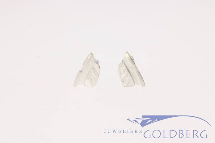 Very beautiful vintage Sterling silver ear studs from world famous Finnish jewelry brand Lapponia. These Ear studs are 14mm long and 7.5mm wide. Designed by Christophe Burger.  For more information visit our site: http://www.goldbergjuweliers.nl/en/vintage-lapponia-prints-earrings-silver.html