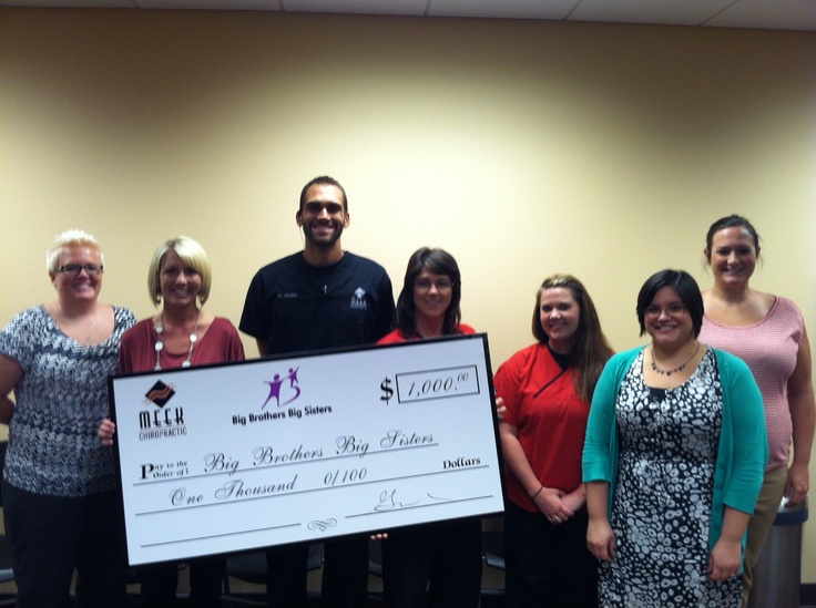 Meek Chiropractic presented Big Brothers Big Sisters of the Ozarks with a check for $1,000.  Money was donated by Meek Chiropractic from patients portions collected July 17, 2012.  Donation will help BBBS buy school supplies for kids to have what they need when they return to school.: Big Brother