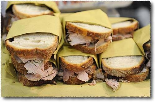 Porchetta sandwiches: a classic of Marche's fast food . The Porchetta is a young pig cooked in the oven until become crusty outside and tender inside.
